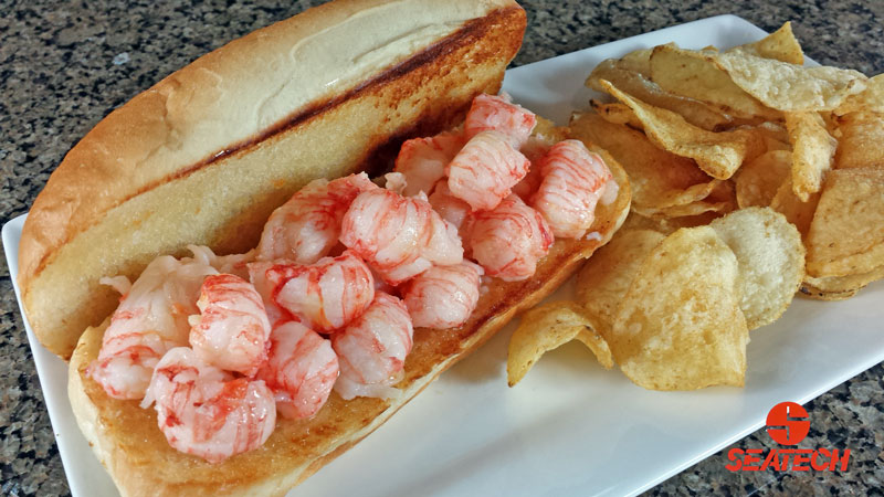 A photograph of a butter boached langostino lobster roll.