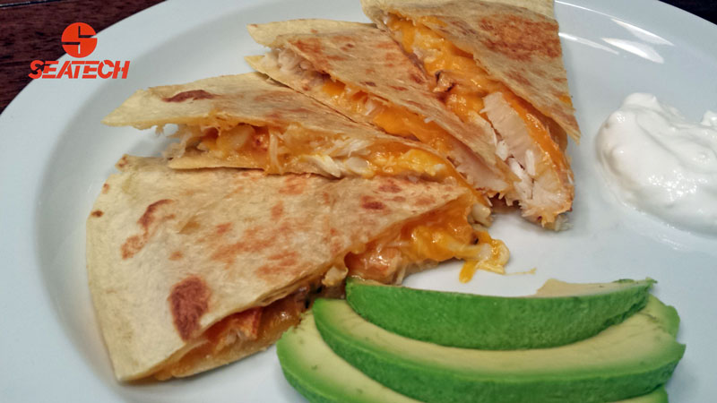 A photograph of a Chilean crab meat quesadill.