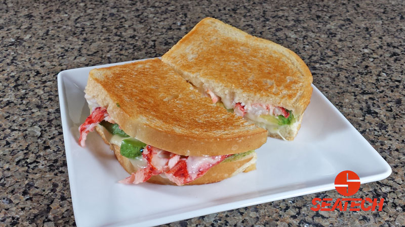 A photograph of a Chilean king crab meat and avocado grilled cheese.