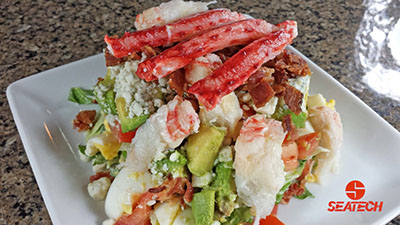 A photograph of a Chilean king crab COBB salad.