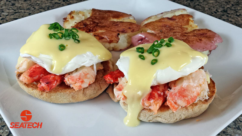 Photograph of Chilean king crab eggs benedict with smashed potatos.