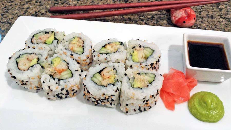 A photograph of California rolls with real crab meat. No surimi here. Who wants fake crab when you can have the real thing.
