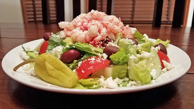 Seatech Cihlean shrimp, lettuce, kalamata olives, tomatoes, cucumbers, red onion, dressing. www.seatechcorp.com