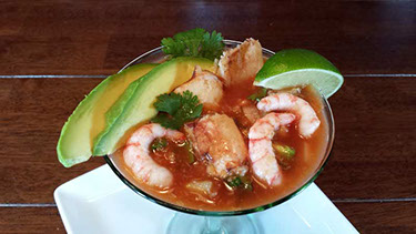 A photograph of a Chilean shrimp mexican cocktail
