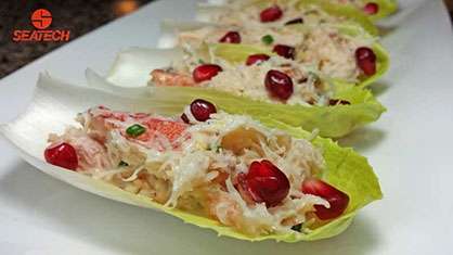Crab Salad On Endive With Pomegranate makes for an excellent holiday gathering appetizer. www.seatechcorp.com
