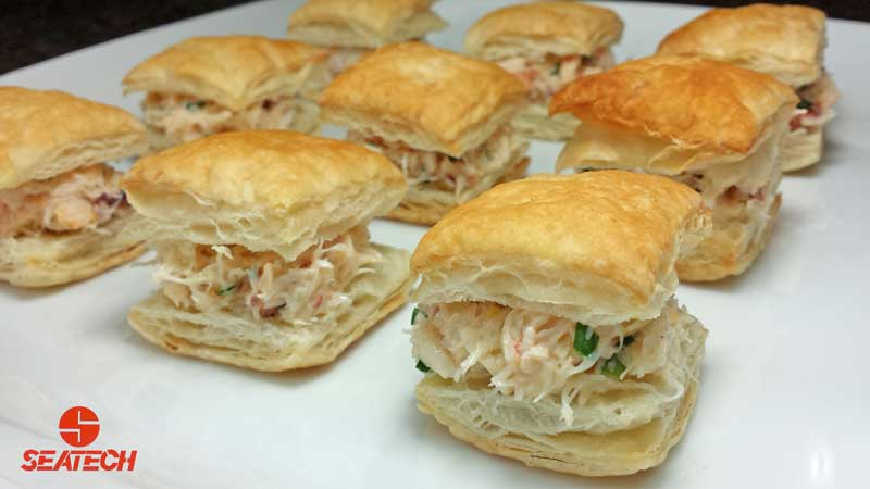 Bite sized puff pastry fill with crab salad.