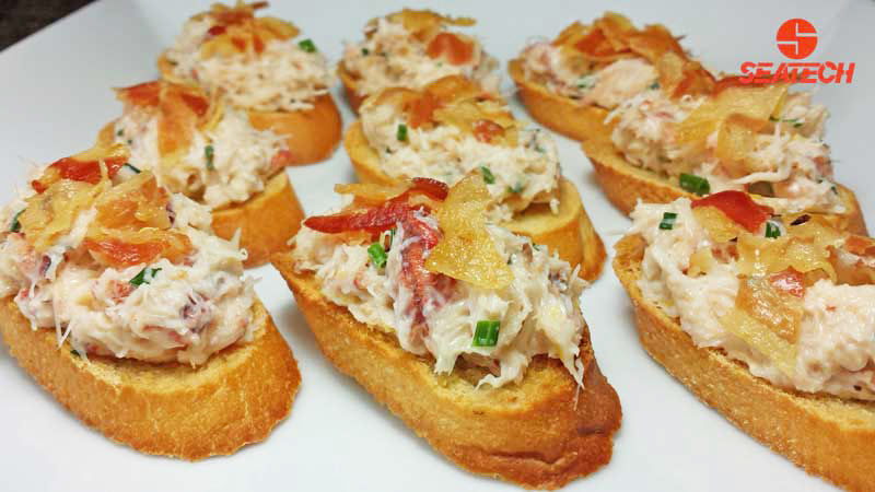 A plate with crab bruschetta topped with crisp pancetta.