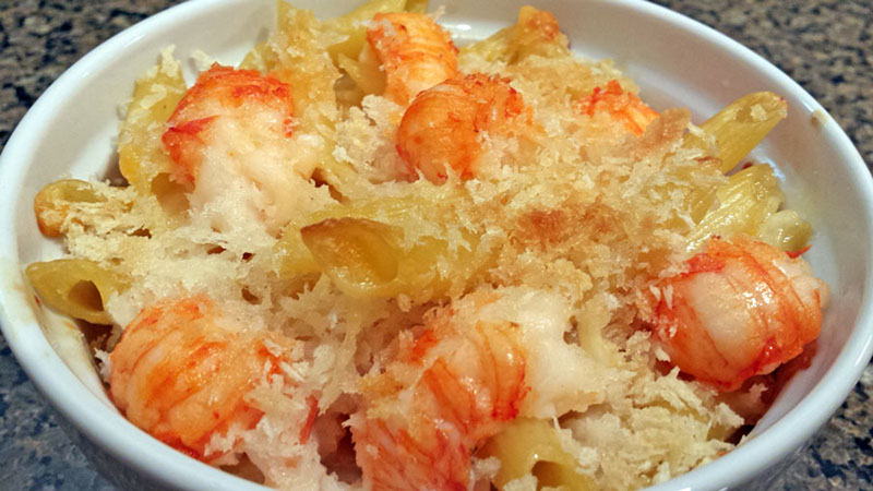 A photograph of freshly made langostino lobster mac and cheese.