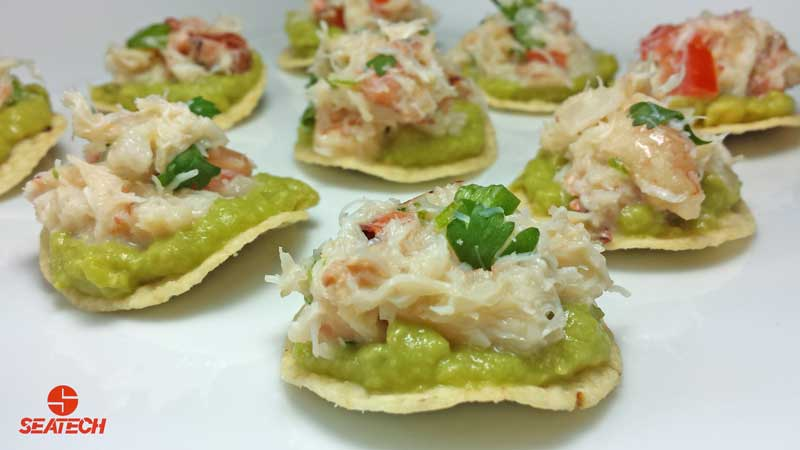 Round tortia chips with a layer of guacamole and than topped with crab ceviche.