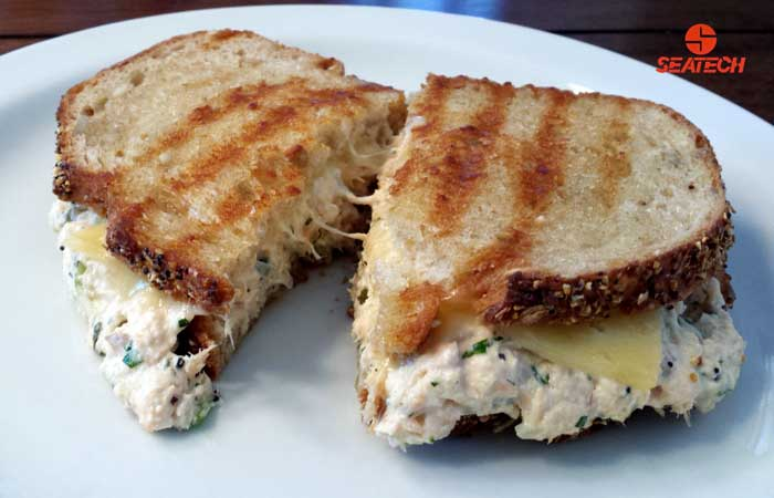 A photograph of a classic salmon salad sandwich.