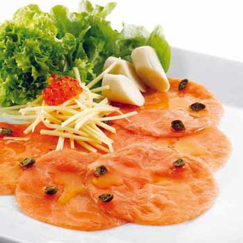 A photograph of salmon carpaccio salad with salmon carpaccio, capers, mozzarella cheese, olive oil and lettuce